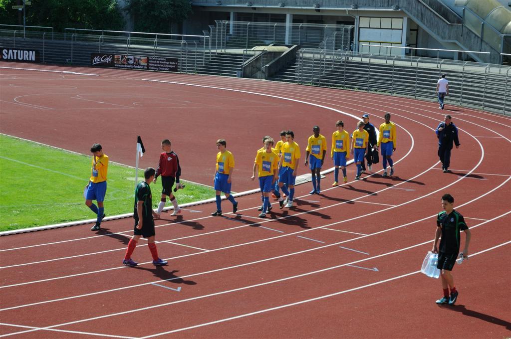 L'équipe de l'AFC arrive sur le terrain pour la finale